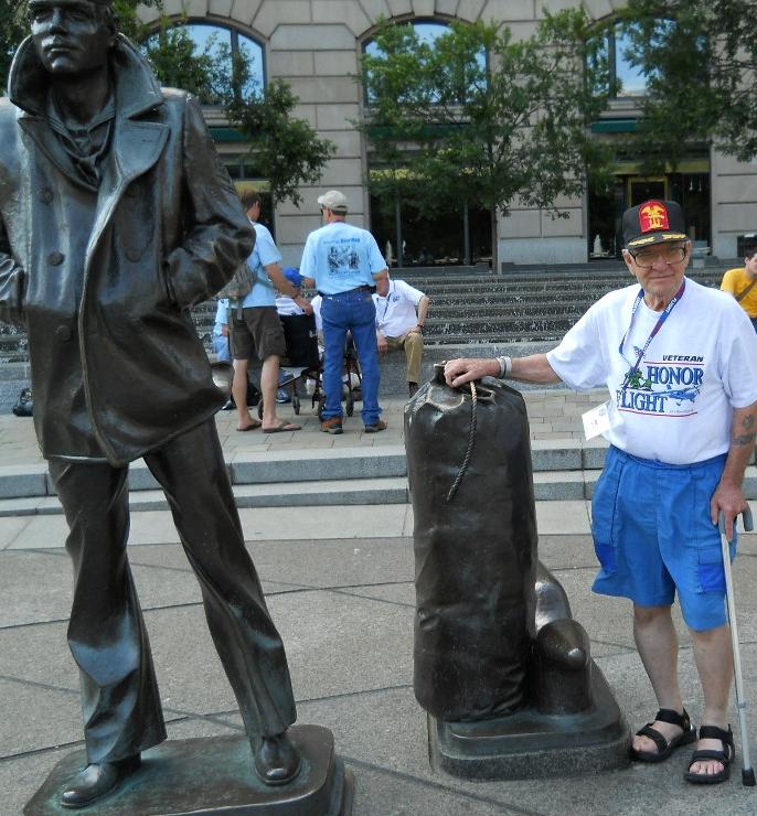 Art Gay at WWII statue sailor & seabag